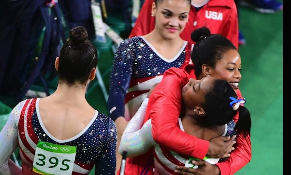 US Women Gymnastics team members  Simone Biles, Gabby Douglas, Aly Raisman, Laurie Hernandez and Madison Kocian congratulate each other on winning the gold