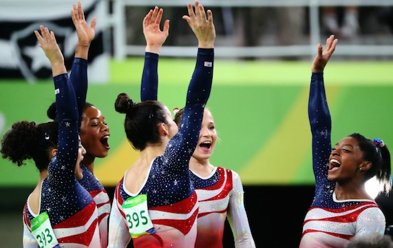 US Women Gymnastics team members  Simone Biles, Gabby Douglas, Aly Raisman, Laurie Hernandez and Madison Kocian celebrate the  gold