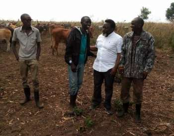 Joseph Kabila with Rwandan workers on his farm